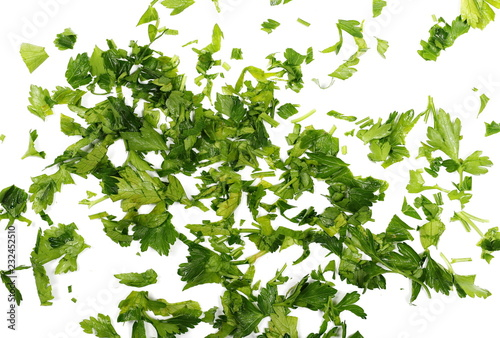Foto op Canvas Aromatische Fresh sliced up green parsley leaves isolated on white background, top view