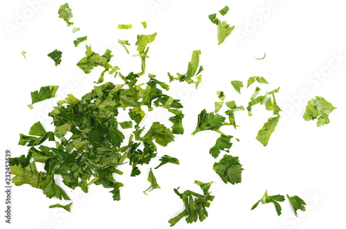 Fresh sliced up green parsley leaves isolated on white background, top view