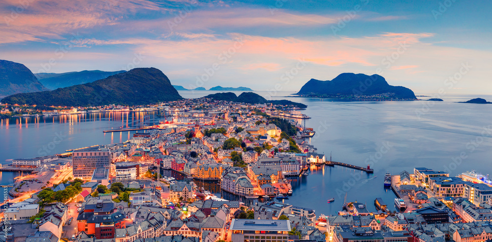 From the bird's eye view of Alesund port town on the west coast of Norway, at the entrance to the Geirangerfjord. Colorful sunset in the Nord. Traveling concept background.