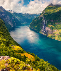 Panel Szklany Do Spa Splendid summer scene of Sunnylvsfjorden fjord, Geiranger village location, western Norway. Aerial view of famous Seven Sisters waterfalls. Beauty of nature concept background.