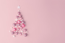 Christmas Composition. Christmas Tree Made Of Pink Ball Decoration On Pink Table Background. Flat Lay, Top View, Copy Space. New Year Sale Card.