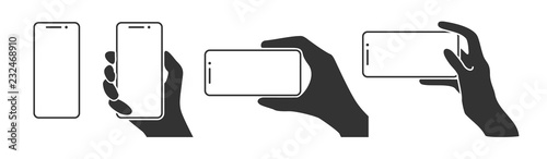 Fotomural Hands holding a phone in horizontal and vertical positions