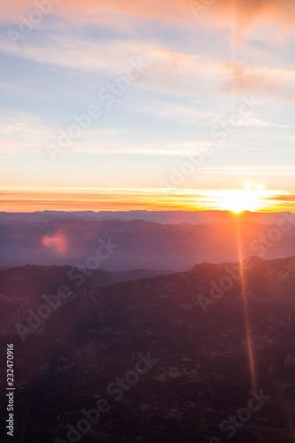 Spoed Foto op Canvas Vuurtoren Sunrise. Sunset in the mountains