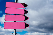 Empty Pink Road Sign Pointers Without Inscriptions Against Blue Sky With Clouds. Space, Place For Text.