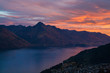 Southern alps mountains with colorful romantic sunset on cloudy sky background, reflection on the lake Wakatipu, Walter Peak Queenstown New Zealand view from the cable car in the city