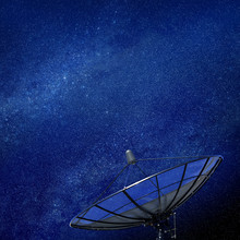 Conceptual Image Of A Satellite Dish Antenna Over Night Sky With Stars Of Galaxy