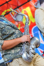 Russia, Samara, September 2017: A Young Man Plays The Saxophone In The Park At The Festival.