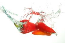 Three Red Parika In Water Splash On White