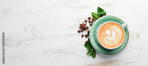 Fototapeta Cappuccino. Coffee with milk. On a white wooden background. Top view. Free copy space. obraz