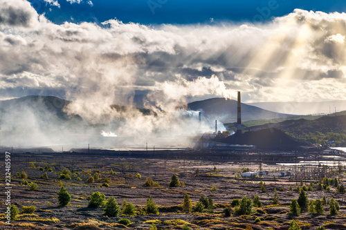 Environmental disaster  Copper plant in valley against the