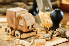 Wooden Toy Truck Van Car On The Carpentry Workbench. Hobby Diy Crafts, Making
