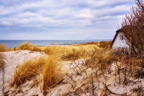 Panorama of the sand dune with house and view of the Baltic Sea.