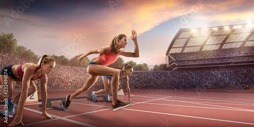 Female athletes sprinting. ...