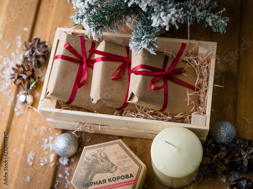 Small Christmas Gifts.Christmas Gifts In A Cardboard Box Under A Small Christmas