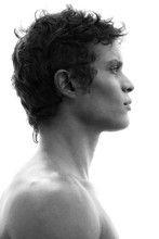 Profile Portrait Of A Fit, Bare-chested Man With Black Hair And Strong Features
