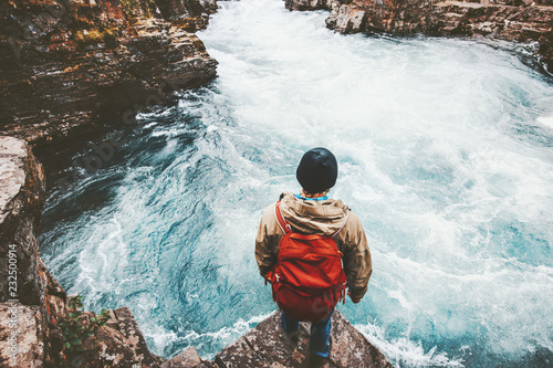 Poster Cappuccino Man traveling with backpack alone in Sweden active lifestyle hiking in river canyon adventure vacations outdoor