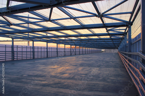 Papiers peints Tunnel Urban Architecture Abstract Street Passage Outdoors. Modern Structure of Empty Bridge Road on Summer Day. Contemporary Urban City Building Interior with Cement Floor, Steel Walls and Open Air Roof