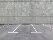 Parking Spaces Along Building Wall. Empty Parking Lot.