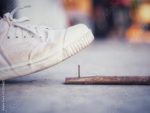 Fotografia, Obraz  Stepping on a dangerous wooden floor may be tetanus.