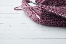 Ball Of Wool Yarn And Knitting Needles On Light Background
