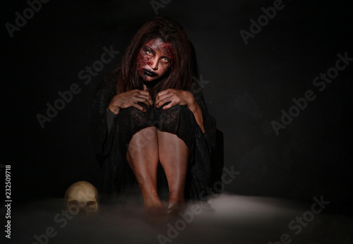 Fotografie, Obraz  Ghost woman sit sad in dark room