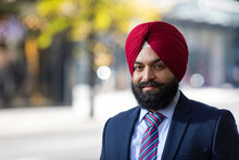 Portrait Of Sikh Business Man Looking To Camera In The City