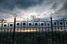Sunset Through A Metal Gate