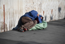 A Homeless Man Sleeps On A Street In Downtown Mexico-City.