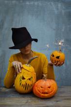 Woman In Hat With Halloween Pumpkins