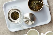 Teapot With Dry Fresh Green Te...