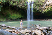 Woman Posing For Photo At Maui, Hawaii Waterfall - Twin Falls In Motion, Tourist Stop On The Road To Hana