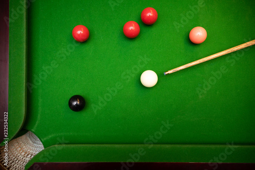 Obraz na plátně  black ball shot in snooker game. top view