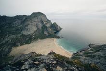 Tiny Hiker Overlooking Beach On Mountain