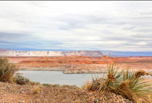 Lake Powell Located In The Glen Canyon National Recreation Area, Is One Of The Largest Man-made Reservoirs On The Colorado River In The United States. Due To Drought And Extra Water Releases, Lowering