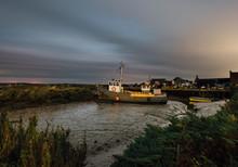 Fishing Boats At Night. Brancaster Staithe, Norfolk, UK.