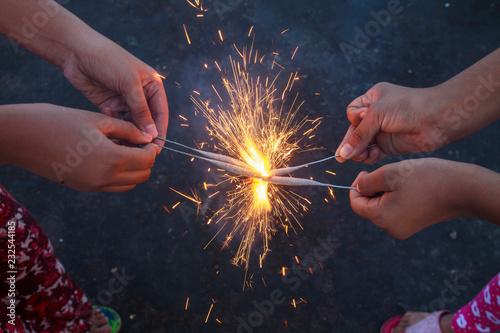 Fotobehang Carnaval Woman's hand holding sparkler
