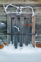 Wooden Door In Snow Decorated With Skulls