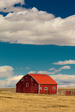 Red Barn In Field With Puffy C...