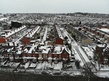 Aerial Photo Over Looking Fields And Houses In The Snow, Taken In Leeds West Yorkshire UK
