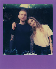 Polaroid Scan Of A Heavily Tattooed Man With Back To The Camera And A Woman Looking At The Camera