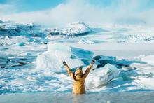 Girl Sitting Near Frozen Lake