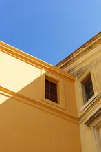 Building Corner From Below Under Blue Sky