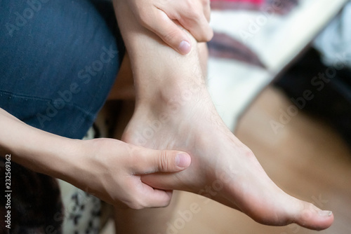 Fototapety, obrazy: person hand touch the ankle, feeling a bone pain f