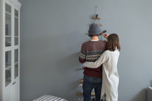 Beautiful Couple Decorating The Christmas Tree