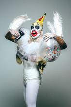 Grotesque Clown With Confetti Balloon