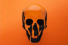 Black Skull With Dripping Oran...