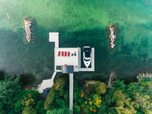 Overhead Drone Image Of A Boathouse On A Lake