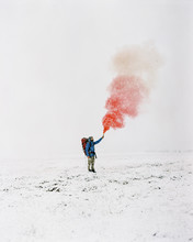 Hiker Holding In Hand Colorful Smoke Bomb