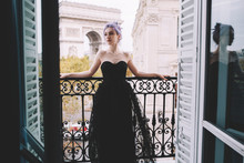 Portrait Of A Young Woman In A Dress On A Terrace In Paris