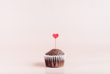One Valentine's Day Cupcake With A Red Heart Ornament